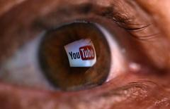 A picture illustration shows a YouTube logo reflected in a person's eye, in central Bosnian town of Zenica, early June 18, 2014. REUTERS/Dado Ruvic