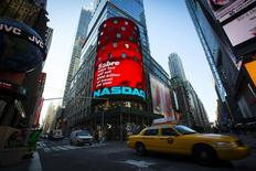 The NASDAQ MarketSite electronic billboard is seen in Times Square in New York, in this file photo taken April 17, 2014. REUTERS/Andrew Kelly/Files