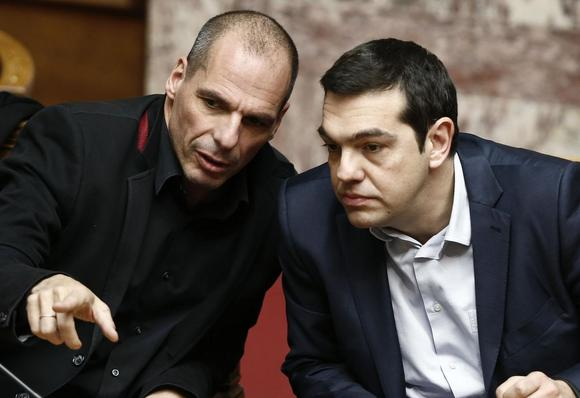 Greek Prime Minister Alexis Tsipras (R) and Finance Minister Yanis Varoufakis talk during the first round of a presidential vote at the Greek parliament in Athens February 18, 2015. REUTERS/Alkis Konstantinidis