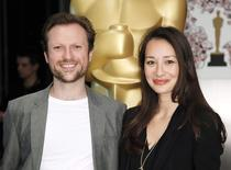 "Filmmakers Joanna Natasegara and Orlando von Einsiedel, of the Oscar-nominated documentary feature ""Virunga,"" pose at a reception ahead of the upcoming 87th Academy Awards ceremony in Beverly Hills, California, February 18, 2015. REUTERS/Danny Moloshok"