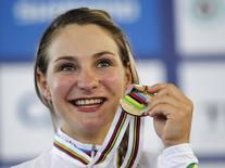 Germany's Kristina Vogel poses with her gold medal on the podium after winning the Women's Keirin during the 2014 UCI Track Cycling World Championships in Cali March 2, 2014.  REUTERS/Jose Miguel Gomez