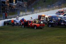 NASCAR Xfinity Series driver Kyle Busch (54) is attended to by medical staff after a wreck during the Alert Florida 300 at Daytona International Speedway. Andrew Weber-USA TODAY Sports