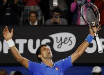 Novak Djokovic of Serbia celebrates after defeating Andy Murray of Britain in their men's singles final match at the Australian Open 2015 tennis tournament in Melbourne February 1, 2015. REUTERS/David Gray