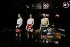 Models present creations from the Anya Hindmarch Autumn/Winter 2015 collection during London Fashion Week February 24, 2015. REUTERS/Suzanne Plunkett