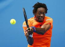 Gael Monfils of France hits a return against Jerzy Janowicz of Poland during their men's singles second round match at the Australian Open 2015 tennis tournament in Melbourne January 22, 2015. REUTERS/Thomas Peter