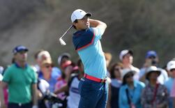 Rory McIlroy of Northern Ireland in action during the final round of the Dubai Desert Classic February 1, 2015. REUTERS/Fadi Al-Assaad