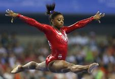 Simone Biles of the U.S. competes on the balance beam during the women's team final event at the 2014 World Artistic Gymnastics Championships in Nanning, Guangxi Zhuang Autonomous Region, October 8, 2014. REUTERS/China Daily