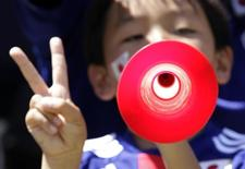 A young Japan soccer supporter plays the vuvuzela before the international friendly soccer match between Japan and Ivory Coast in Sion June 4, 2010.   REUTERS/Denis Balibouse