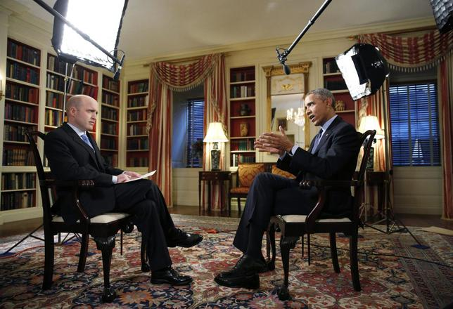 U.S. President Barack Obama (R) speaks during an exclusive interview with White House Correspondent Jeff Mason in the Library of the White House in Washington March 2, 2015. RREUTERS/Kevin Lamarque