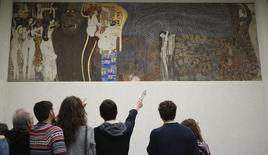Visitors look at Gustav Klimt's Beethoven Frieze, one of the country's most famous artworks, at the Secession museum in Vienna March 5, 2015.   REUTERS/Leonhard Foeger