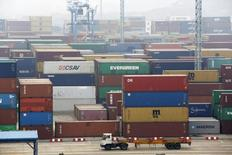 A trailer loaded with container boxes travels in Ningbo port in Zhejiang province, January 22, 2015. REUTERS/William Hong