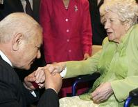 Albanian Xhemil Cala (L) puts the ring of the British flight engineer Sergeant John Thompson, onto the finger of his sister Dorothy Webster, 92, during a ceremony held at the Ministry of Defence in Tirana March 9, 2015.  REUTERS/Arben Celi
