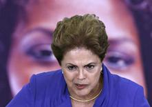 Brazil's President Dilma Rousseff speaks during a ceremony for the International Women's Day at Planalto Palace in Brasilia March 9, 2015.   International Women's Day is commemorated annually on March 8.    REUTERS/Ueslei Marcelino (BRAZIL - Tags: SOCIETY POLITICS)