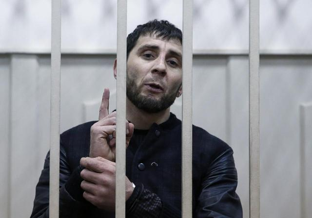 Zaur Dadayev, charged with involvement in the murder of Russian opposition figure Boris Nemtsov, speaks inside a defendants' cage in Moscow, Russia March 8, 2015. REUTERS/Tatyana Makeyeva