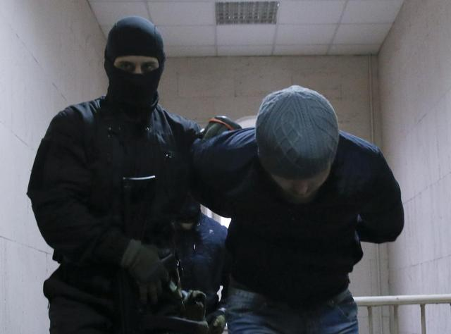 Anzor Gubashev, detained over the killing of Boris Nemtsov, is escorted inside a court building in Moscow, March 8, 2015.  REUTERS/Maxim Shemetov