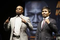 """Eleven-time, five-division world boxing champion Floyd """"Money"""" Mayweather (L) and eight-division world champion Manny """"Pac-Man"""" Pacquiao pose at a news conference ahead of their upcoming bout, in Los Angeles, California March 11, 2015.  REUTERS/Lucy Nicholson"""
