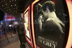 "A film poster for ""Fifty Shades of Grey"" is pictured at Regal Theater in Los Angeles, California, February 12, 2015. REUTERS/Jonathan Alcorn"