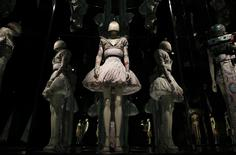 A dress from the Alexander McQueen It's Only a Game, spring/summer 2005 collection is reflected in mirrors in the Alexander McQueen: Savage Beauty exhibition at the V&A in London, March 12, 2015. REUTERS/Suzanne Plunkett