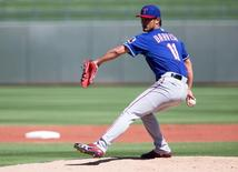 Texas Rangers pitcher Yu Darvish (11) throws a pitch in the first inning during a spring training baseball game against the Kansas City Royals at Surprise Stadium. Mar 5, 2015; Surprise, AZ, USA;  Allan Henry-USA TODAY Sports