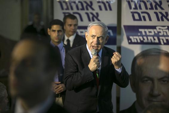 Israel's Prime Minister Benjamin Netanyahu gestures as he speaks to supporters of his Likud party as he campaigns in Netanya, north of Tel Aviv  March 11, 2015.  REUTERS/Baz Ratner