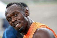 Jamaica's Usain Bolt smiles shortly after crossing the finish line first, in his first race of the season during the Gibson Relays in Kingston February 28, 2015. REUTERS/Gilbert Bellamy