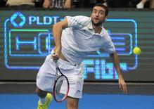 Marin Cilic of the UAE Royals makes a serve to Gael Monfils of the Indian Aces during their men's single match at the International Premier Tennis League (IPTL) in Manila November 30, 2014.       REUTERS/Romeo Ranoco
