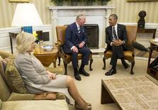 U.S. President Barack Obama (R) meets with Britain's Prince Charles, Prince of Wales, and his wife Camilla, the Duchess of Cornwall, in the Oval Office of the White House in Washington March 19, 2015.  REUTERS/Joshua Roberts