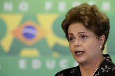 Brazil's President Dilma Rousseff reacts during a ceremony to announce measures to modernize Brazilian soccer at the Planalto Palace in Brasilia March 19, 2015. REUTERS/Ueslei Marcelino