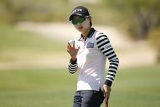 Mar 20, 2015; PHOENIX, AZ, USA; Hyo Joo Kim makes birdie at the 5th hole during round two action of the JTBC Founders Cup at Wildfire Golf Club at JW Marriott Phoenix Desert Ridge Resort & Spa. Rob Schumacher-USA TODAY Sports