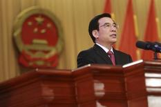 Wang Anshun delivers his government work report speech during the opening ceremony of the Beijing Municipal People's Congress at the Beijing Conference Centre January 22, 2013. REUTERS/China Daily