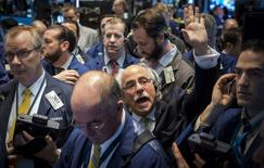 Traders wait for the opening of Whiting Petroleum's stock on the floor of the New York Stock Exchange March 24, 2015.  REUTERS/Brendan McDermid