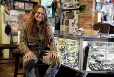 Kathleen Chippi poses in her shop in Nederland, Colorado March 14, 2015.   REUTERS/Rick Wilking