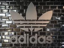 The Adidas logo is pictured in a pop-up store in Berlin December 2, 2014.  REUTERS/Hannibal Hanschke