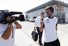 McLaren's Fernando Alonso gestures as he leaves the medical centre.  Formula One - F1 - Malaysian Grand Prix 2015 - Sepang International Circuit, Kuala Lumpur, Malaysia - 26/3/15. Reuters / Olivia Harris