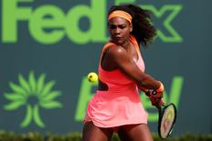 Mar 28, 2015; Key Biscayne, FL, USA; Serena Williams hits a backhand against Monica Niculescu (not pictured) on day six of the Miami Open at Crandon Park Tennis Center.  Geoff Burke-USA TODAY Sports