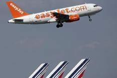 An easyJet aircraft takes-off past Air France plane tails at the Charles-de-Gaulle airport, near Paris, September 16, 2014.   REUTERS/Christian Hartmann
