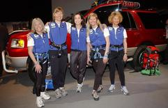 Alison Levine (third from left) at the New York International Auto Show in Manhattan, March 28, 2002. REUTERS/Chip East