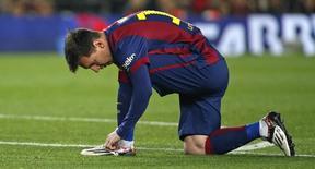 Messi durante jogo do Barcelona com o Real Madrid. 22/03/2015.    REUTERS/Paul Hanna