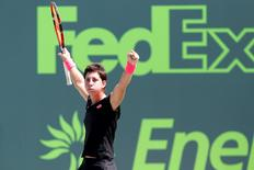 Apr 2, 2015; Key Biscayne, FL, USA; Carla Suarez Navarro celebrates after her match against Andrea Petkovic (not pictured) in a women's singles semi-final on day eleven of the Miami Open at Crandon Park Tennis Center. Navarro won 6-3, 6-3. Mandatory Credit: Geoff Burke-USA TODAY Sports