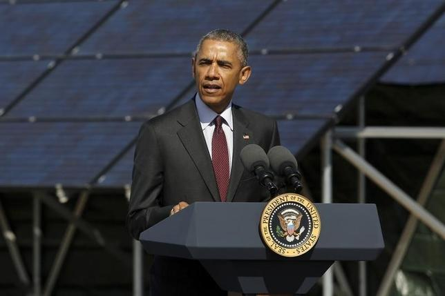 U.S. President Barack Obama delivers remarks on clean energy after a tour of a solar power array at Hill Air Force Base, Utah April 3, 2015. REUTERS/Jonathan Ernst