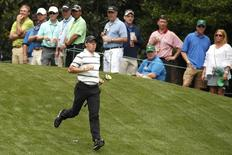 Rory McIlroy of Northern Ireland runs down the 11th fairway during his practice round ahead of the 2015 Masters at the Augusta National Golf Course in Augusta, Georgia April 6, 2015.  REUTERS/Phil Noble