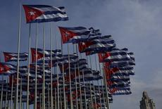 REFILE - CLARIFYING CAPTION  Cuban flags, raised to celebrate the 53rd anniversary of the Young Communist League (UJC) and the 54th anniversary of the Jose Marti Pioneers Organization (OPJM), fly beside the United States Interests Section in Havana (USINT), in Havana April 5, 2015.