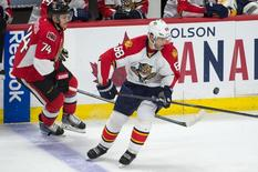 Mar 29, 2015; Ottawa, Ontario, CAN; Florida Panthers right wing Jaromir Jagr (68) and Ottawa Senators defenseman Mark Borowiecki (74) battle for the puck in the third period at the Canadian Tire Centre. Mandatory Credit: Marc DesRosiers-USA TODAY Sports - RTR4VE7D