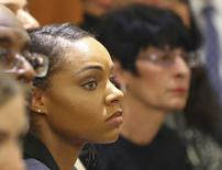 Shayanna Jenkins (L), the girlfriend of former New England Patriots football player Aaron Hernandez, and his mother Terri Hernandez listen to the judge give instructions to the jury during his murder trial in Fall River, Massachusetts April 7, 2015.   REUTERS/John Tlumacki/Pool