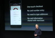 Apple CEO Tim Cook speaks about the Apple Pay service during a presentation at Apple headquarters in Cupertino, California October 16, 2014.  REUTERS/Robert Galbraith
