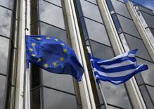 A Greek and an EU flag flutter outside the Foreign Ministry in Athens March 12, 2015. REUTERS/Yannis Behrakis