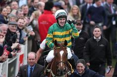 Horse Racing - Cheltenham Festival - Cheltenham Racecourse - 12/3/15 Tony McCoy on Uxizandre celebrates after winning the 14:40 Ryanair Chase Action Images via Reuters / Matthew Childs Livepic