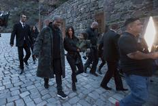 U.S. television personality Kim Kardashian (C), together with her rapper husband Kanye West and their daughter North, visits the Geghard monastery in the Armenian province of Kotayk April 9, 2015. REUTERS/Vahan Stepanyan/PAN Photo