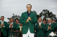 Jordan Spieth of the U.S. wears his traditional green jacket after winning the Masters golf tournament at the Augusta National Golf Course in Augusta, Georgia April 12, 2015.   REUTERS/Jim Young