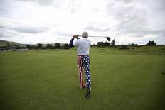 Eric Frost, who is on a golfing holiday from Freeland, Michigan, U.S., poses for a photograph as he hits a tee shot in Perthshire, Scotland, August 19, 2014.   REUTERS/Paul Hackett